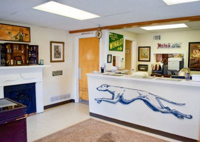 Reception Desk with Antique Greyhound Bus Sign