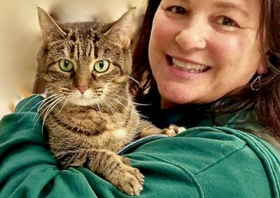 Woman Posing With Green Eyed Cat