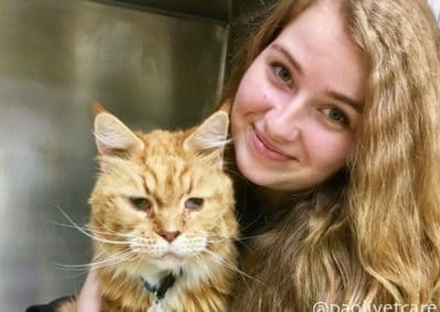 Kennel Assistant Kimberly with a vomiting cat